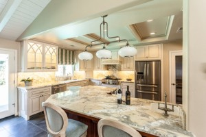 bright-kitchen-with-custom-cabinets-and-marble-countertops