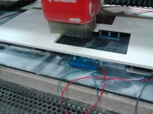 CNC-machine-cuts-custom-granite-shape