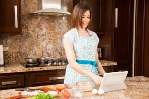 woman-standing-at-counter-preparing-meal